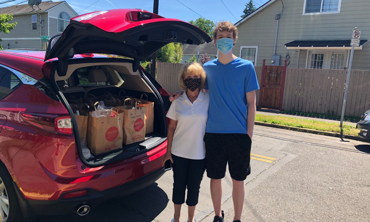 Woman and boy filling the truck with bags of food