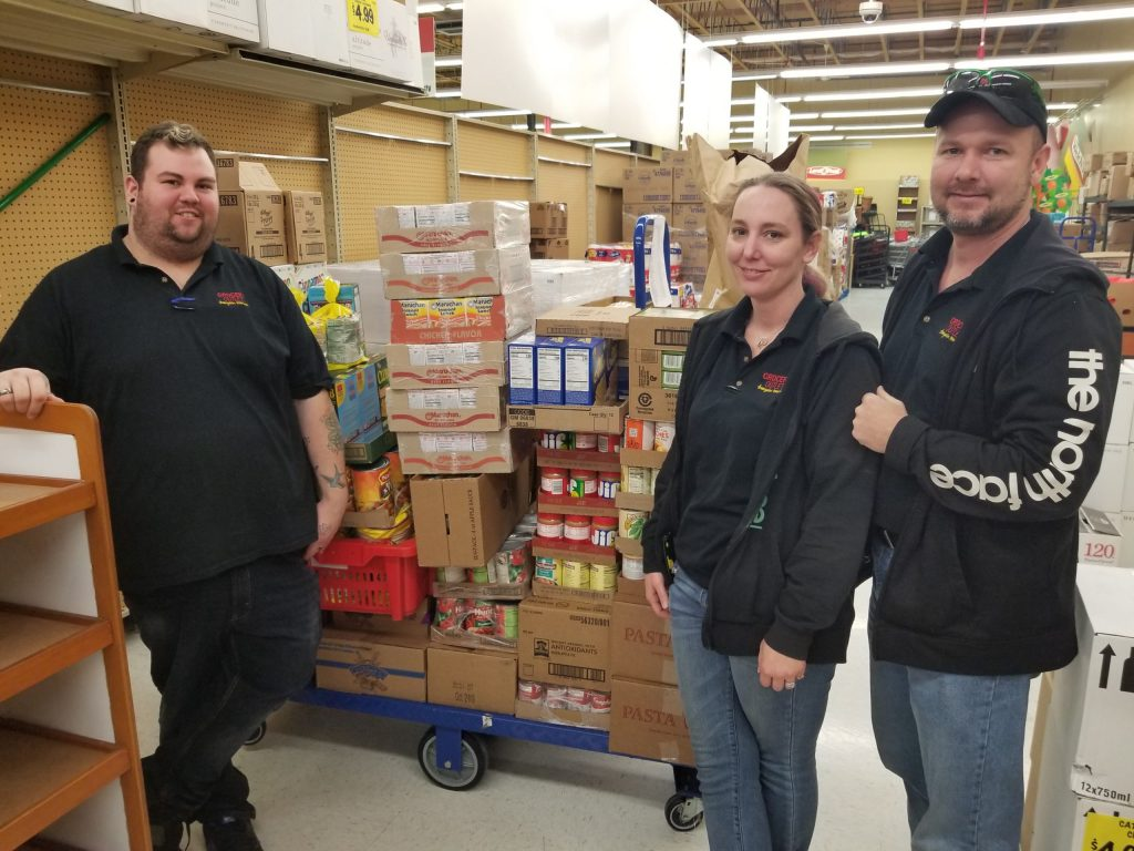 volunteers with a cart full of food